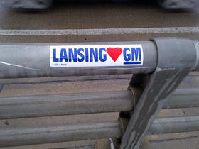 Bumper sticker with Lansing Loves GM