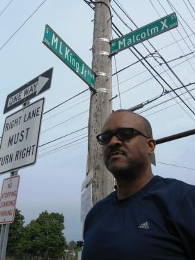 Dennis Burnside co-founded the X Foundation, the group which successfully pushed for Main Street in Lansing to be re-named for Malcolm X.  Lansing and New York City are the only two known cities in which streets named for Malcolm X and Martin Luther King, Jr. intersect.