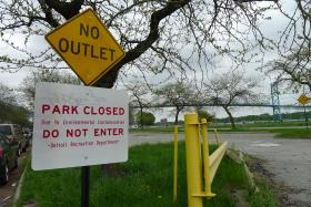 Riverside Park in Detroit. Despite the sign, cars were lined up and the park was full of people fishing on a weekend in mid-May.