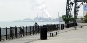 Fishing along the Detroit River near the Ambassador Bridge, looking back at Rouge pollution.