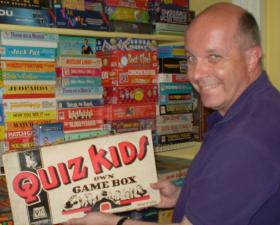 Ottinger with a prize from his board game collection.