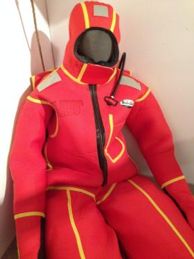 This survival suit, part of the 'Lake Effects' exhibit at the Michigan Historical Museum, is designed for protection and flotation in frigid waters.