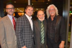 Folk singer Arlo Guthrie (right) recently joined VOA VP Patrick Patterson, committee chairman Kevin McGraw and honoree Fr. Jake Foglio at an event honoring veterans.
