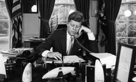 President John F. Kennedy at his desk in the Oval Office, 1962.
