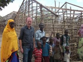Owen Anderson (center) with an Orma family in Kenya's Kipao village.