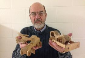 Larry Koster with a few of the toys he's made for the R.J. Scheffel Memorial Toy Project.