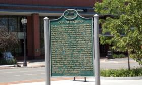A Michigan historical marker in Lansing tells the story of the Old Newsboys.