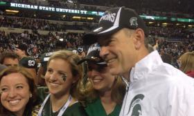 MSU football coach Mark Dantonio celebrates Saturday's victory over Ohio State in the Big Ten championship game.