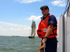 Coast Guard Auxiliarist Tony Pizzo stands watch during the 2013 Tall Ship Celebration in Bay City.