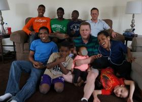 Plaintiffs Clint McCormack (front), Bryan Reamer (back), and some of their 13 children.