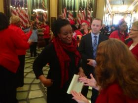 Danielle Atkinson of the Raise Michigan Coalition, and founder of Mothering Justice, speaking with Democratic lawmakers Tuesday at an equal pay rally in the state Capitol.