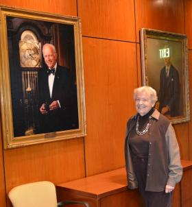 Pauline Adams with a portrait of her husband, former MSU president Walter Adams.