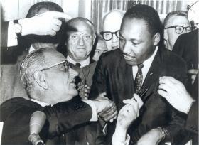 President Lyndon Johnson signed the Civil Rights Act into law 50 years ago today. Dr. Martin Luther King Jr. attended the ceremony.