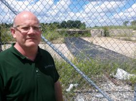 Lansing Township Planning and Development Director Steven Hayward stands at the site of the former General Motors metal forge along West Saginaw. GM used the solvent 1,4 dioxane in its manufacturing process before the plant was shut down a decade ago. The contamination will be cleaned up by RACER Trust, the company charged with managing some 90 former General Motors properties across the country.