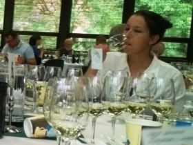 Guest wine judge Courtney Casey samples a collection of local wines at the 37th annual Michigan Wine Competition at MSU.