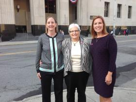 Lead plaintiffs Glenna DeJong (l) and Marsha Caspar (center) join Ingham County Clerk Barb Byrum (r) outside the federal court building in Detroit on Thursday.  DeJong and Caspar were the first same-sex couple to get married in Michigan. Byrum officiated their wedding.