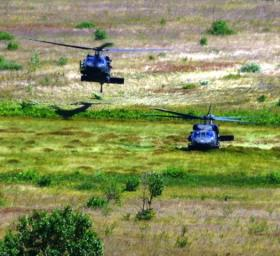 U.S. Army Blackhawk helicopters land on a simulated battlefield at Camp Grayling.  The post is hosting soldiers from across the U.S. for Operation Northern Strike.
