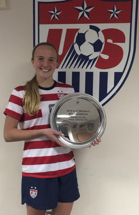 Morse holding a plaque from the U-17 NTC Invitational in Carson, California.