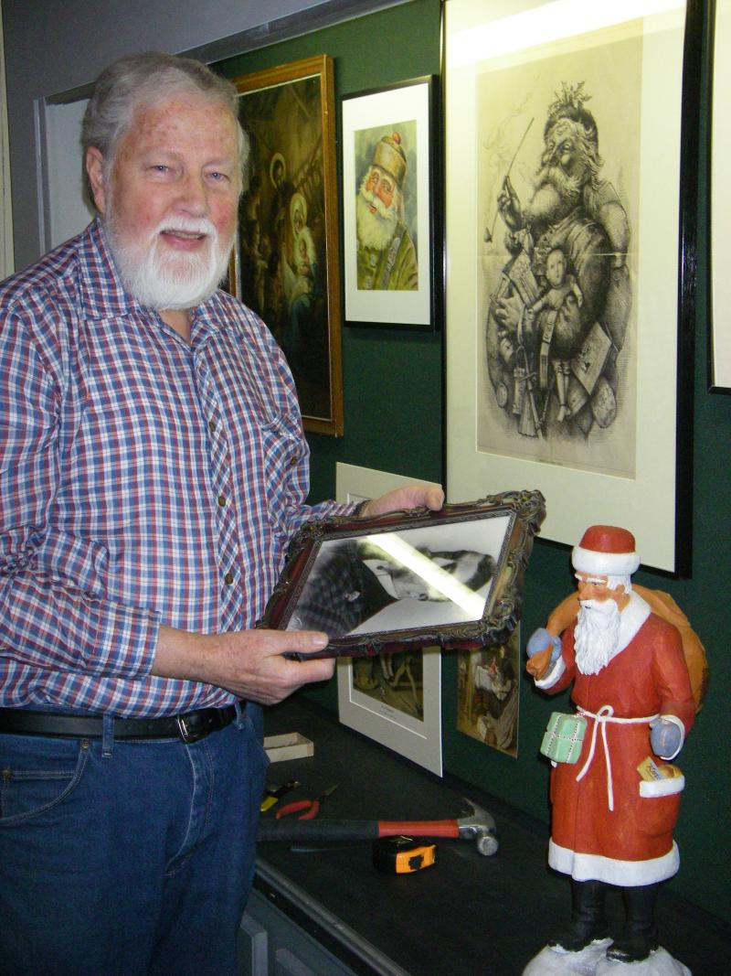 "MSU Museum curator Val Berryman at ""The Art of Christmas"" exhibit at the Williamston Depot Museum."