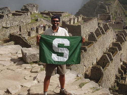 On many of his stops, Sam Singh posed for pictures with his MSU flag. Here he is at Machu Picchu, Peru.