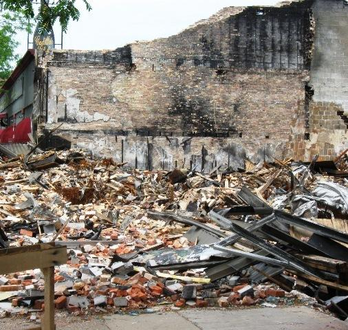 Investigators say the May 3 fire at Discount Dave's in south Lansing was deliberately set.