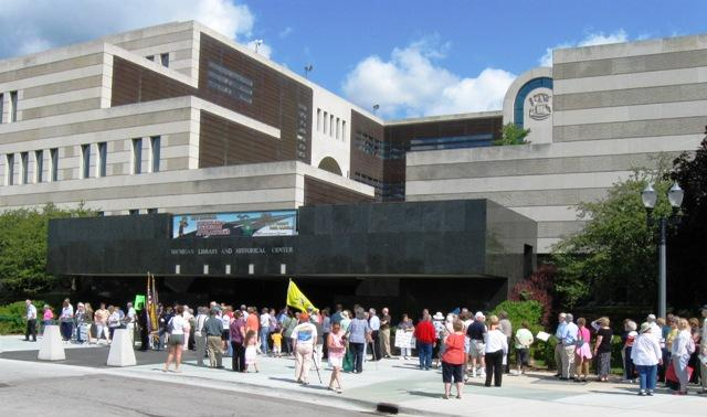 Hundreds of people rally at the Michigan Historical Center to voice their concerns for its future.