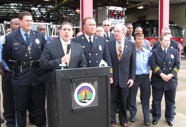 Lansing Mayor Virg Bernero decries possible state revenue sharing cuts during a press conference at a city fire station.