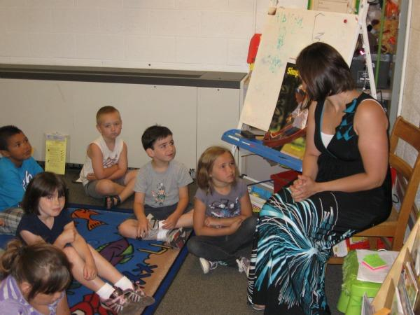 Sycamore elementary school teacher Lindsey Harris and her kindergarteners.  Sycamore and other schools are taking measures to keep learning alive in the summer. photo: Mark Bashore/WKAR