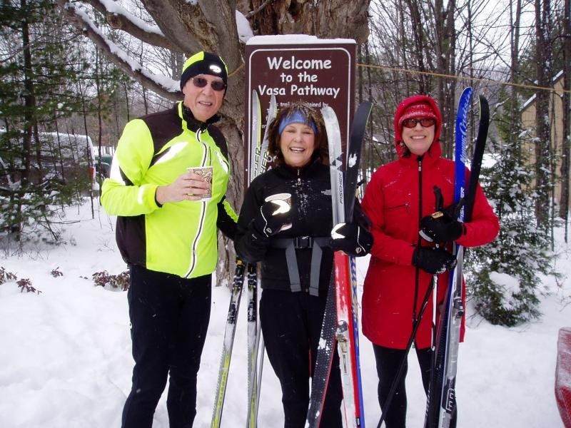 Cross-country skiers at the Vasa Pathway, maintained and groomed by TART Trails.