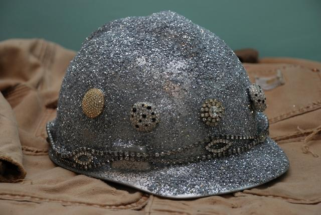 Susan Eisenberg's decorated hardhat piece is called Stella's Hat.