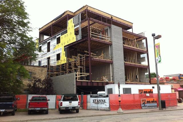 Work has begun on a fifth floor at the St. Anne Luxury Lofts in downtown East Lansing. The city council had only approved four stories.