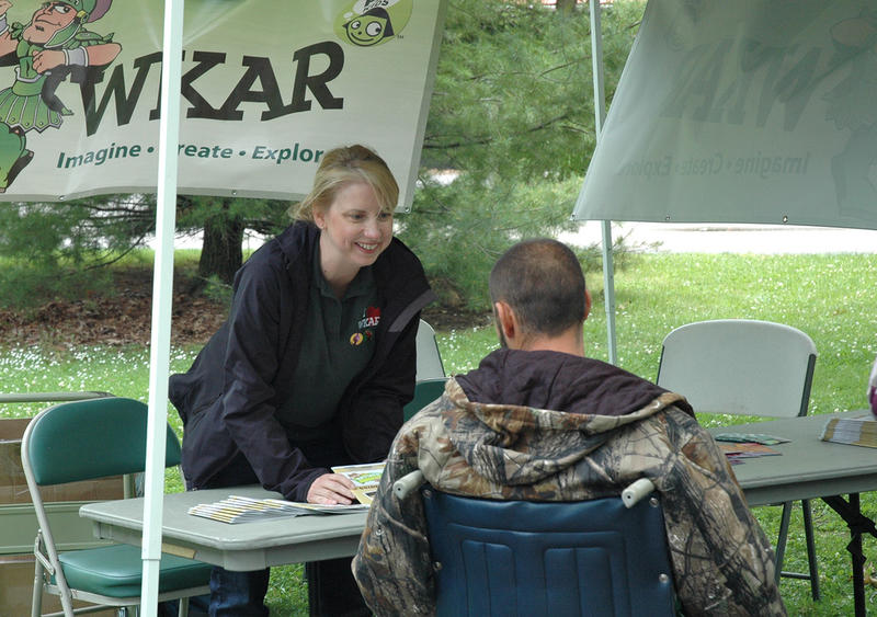 WKAR station manager Susi Elkins greets a guest at Potter Park Zoo.