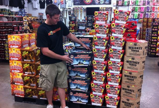 Justin Morris stocks fireworks at American Eagle Superstore in Lansing.