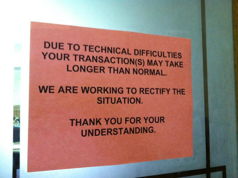 A sign at the Ingham County Clerk's office in Mason advises residents of possible delays getting documents.