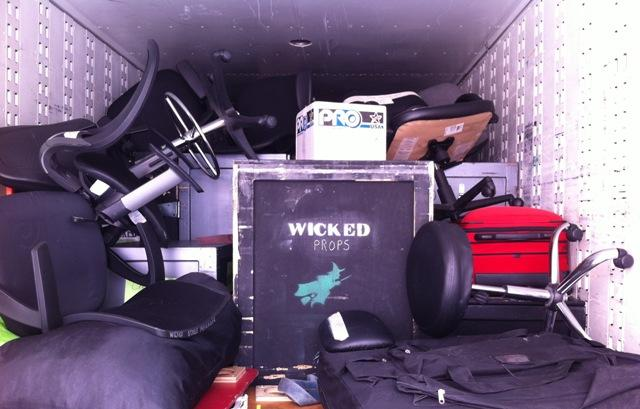 "Boxes of ""Wicked"" props and set pieces were moved by truck."