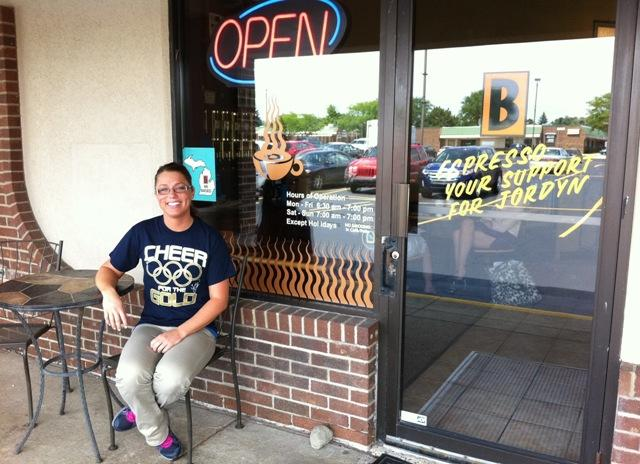 Biggby Coffee manager Marcy Powelson wears one of the T-shirts sold to help send Jordyn Wieber's family to London for the Olympic Games.