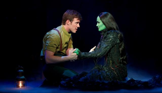"Billy Tighe, as Fiyero, sings with Elphaba (Christine Dwyer) in ""Wicked""."