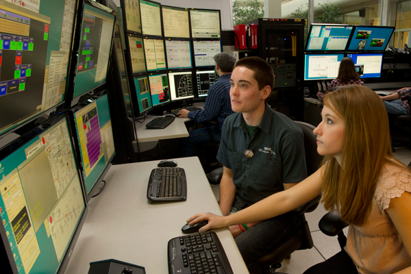 Operator and student at control panel