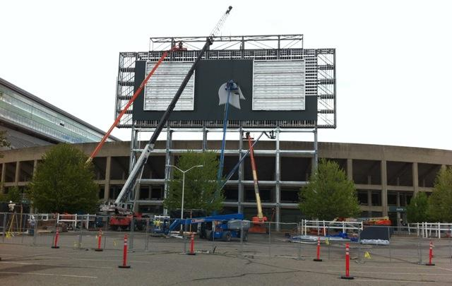 Workers began installing a helmet logo on the south scoreboard at Spartan Stadium Thursday. Along with new video boards, the stadium is getting new audio equipment.