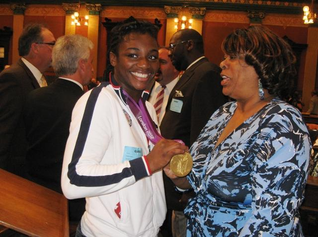 State Rep. Alberta Tinsley-Talabi (D-Detroit) congratulates Shields on her accomplishment.
