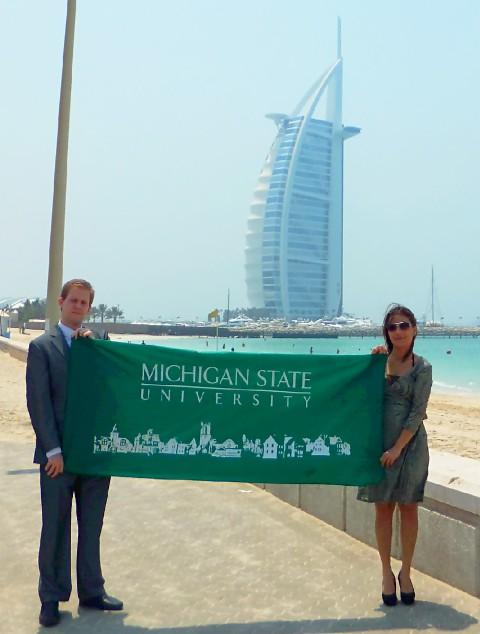 MSU-Dubai Marketing and Recruitment Manager Stephen Fallon, with Office Coordinator Lulett Escarpe. In the background is the landmark Burj Al Arab hotel.