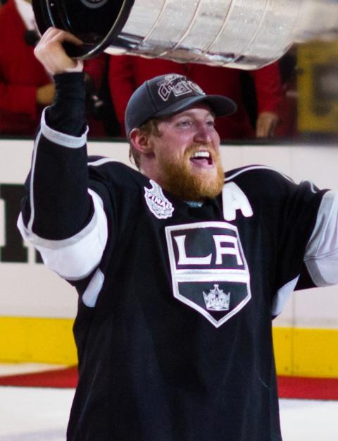 Defenseman Matt Greene of Grand Ledge hoists the Stanley Cup. His L.A. Kings are NHL champions. He'll bring the Cup to Grand Ledge on Friday.
