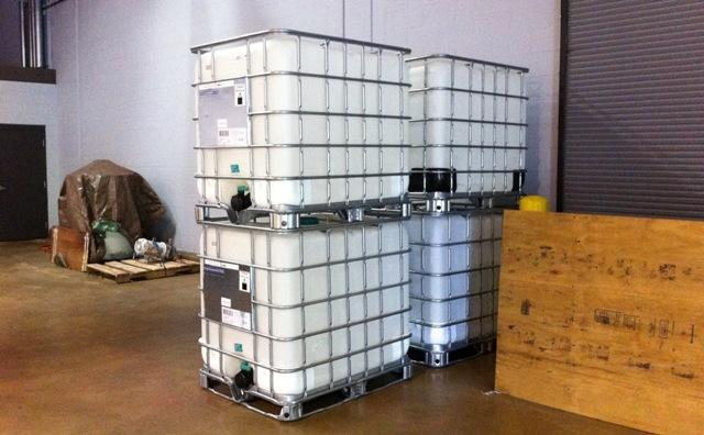 Plastic totes holding 275 gallons of Superzilla are used for shipping to an aerosol filler.