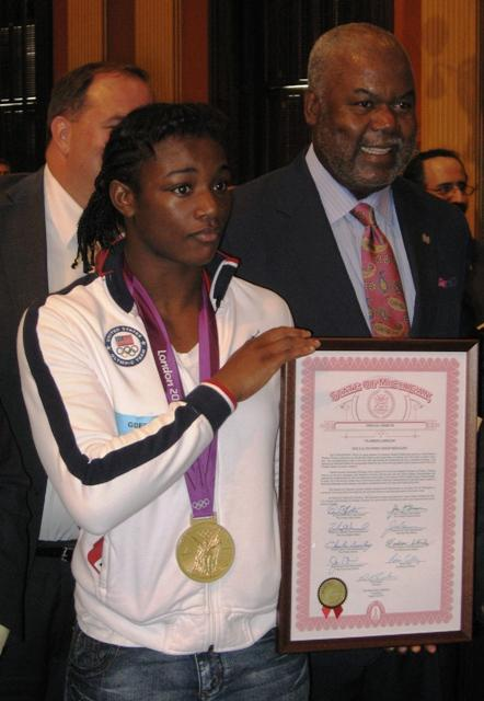 Olympic gold medalist Claressa Shields receives a proclamation from the State of Michigan recognizing her achievement.