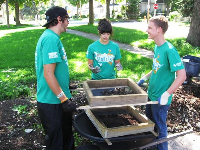 MSU students sift soil as part of a community garden improvement project in Lansing's Eastside neighborhood.