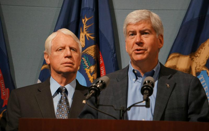 Blue Cross-Blue Shield of Michigan would become a policyholder-owned company under changes outlined by Gov. Rick Snyder. The governor explains his proposal as Department of Community Health Director James Haveman looks on.