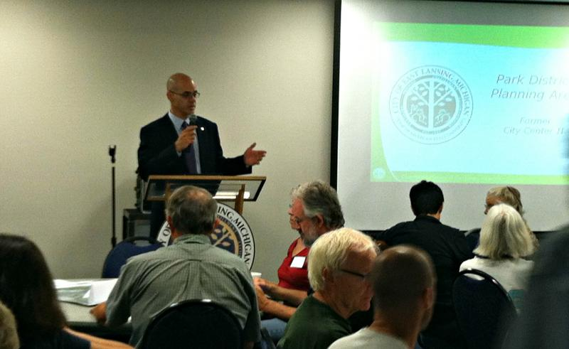 East Lansing City Manager George Lahanas welcomes participants to Friday's gathering to discuss downtown development.
