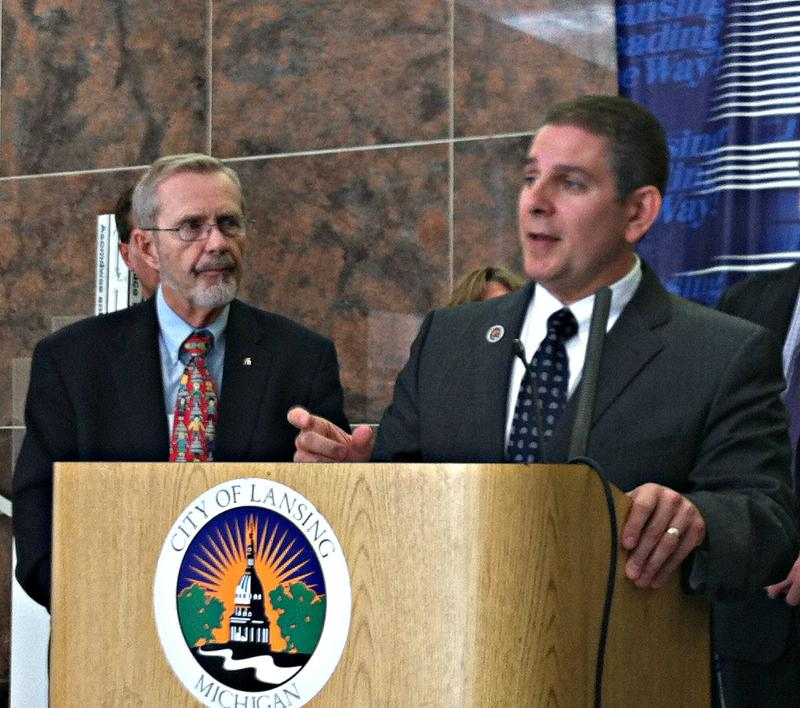 Lansing Mayor Virg Bernero introduces ex-Mayor David Hollister as chair of the administration's new 'Financial Health Team' last week in city hall.