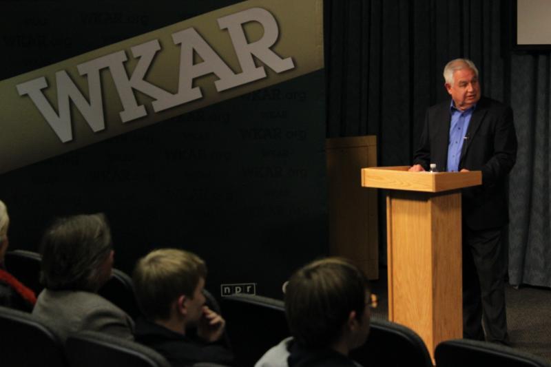 Moderator at podium