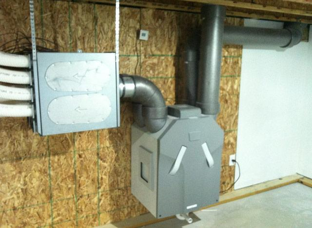 "A ventilation unit is a standard fixture of passive homes.  Such tightly-sealed structures need ""lungs."""